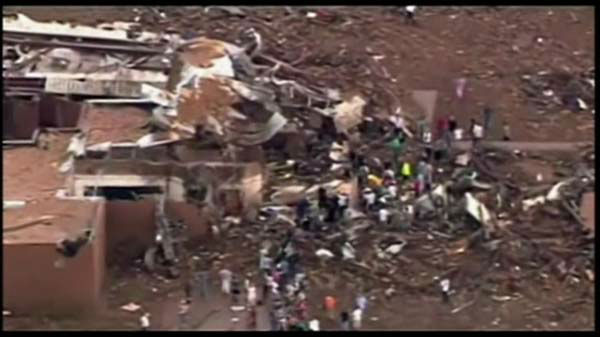 "<div class=""meta ""><span class=""caption-text "">Extensive damage in Moore, Oklahoma, after a tornado struck the town on Monday, May 20, 2013.  (WLS Photo)</span></div>"