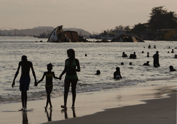 2. Luanda: Angolans relax on a beach at sunset on the Ilha, in Luanda, Angola in this Saturday, Jan. 30, 2010 file photo. <span class=meta>( AP Photo&#47;Rebecca Blackwell)</span>