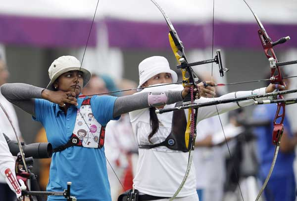 "<div class=""meta ""><span class=""caption-text "">India's Deepika Kumari, left, shoots next to Mexico's Aida Roman during an individual ranking round at the 2012 Summer Olympics, Friday, July 27, 2012, in London. (AP Photo/Marcio Jose Sanchez)</span></div>"
