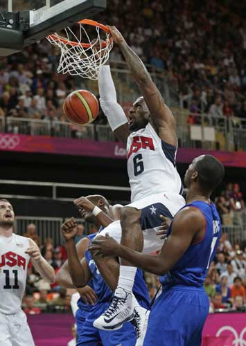 USA&#39;s Lebron James dunks during the first half of a preliminary men&#39;s basketball game against France at the 2012 Summer Olympics, Sunday, July 29, 2012, in London.  <span class=meta>(AP Photo&#47;Charles Krupa)</span>