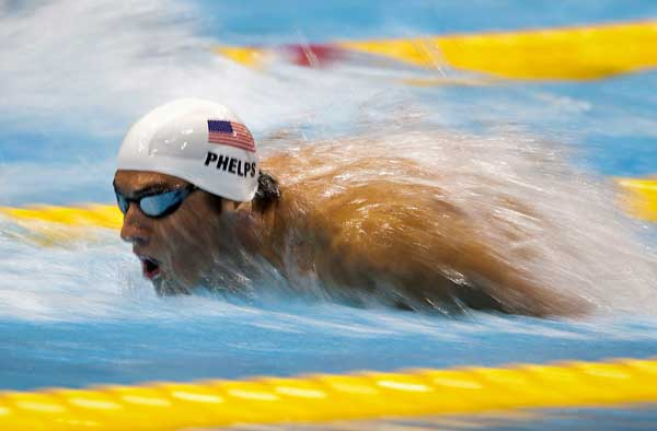 Michael Phelps of the USA explodes out of the water in his swimming heat in the Men&#39;s 200m Butterfly at the Olympic Games in London on Monday July 30, 2012.  <span class=meta>(AP Photo&#47;The Canadian Press, Frank Gunn)</span>