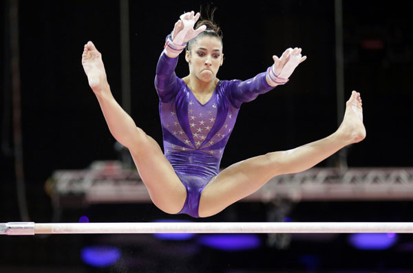 U.S. gymnast Alexandra Raisman performs on the uneven bars during the Artistic Gymnastics women&#39;s qualification at the 2012 Summer Olympics, Sunday, July 29, 2012, in London. <span class=meta>(AP Photo&#47;Gregory Bull)</span>