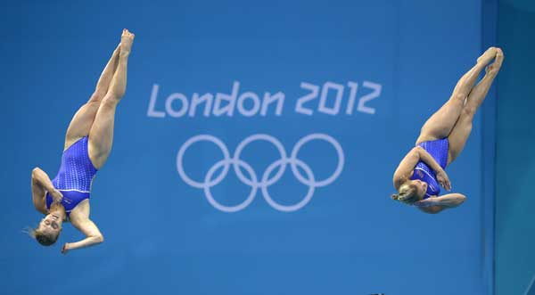 Abigail Johnston and Kelci Bryant of the USA compete during the 3 Meter Synchronized Springboard final at the Aquatics Centre in the Olympic Park during the 2012 Summer Olympics in London, Sunday, July 29, 2012. USA won the silver medal in the event.  <span class=meta>(AP Photo&#47;Mark J. Terrill)</span>