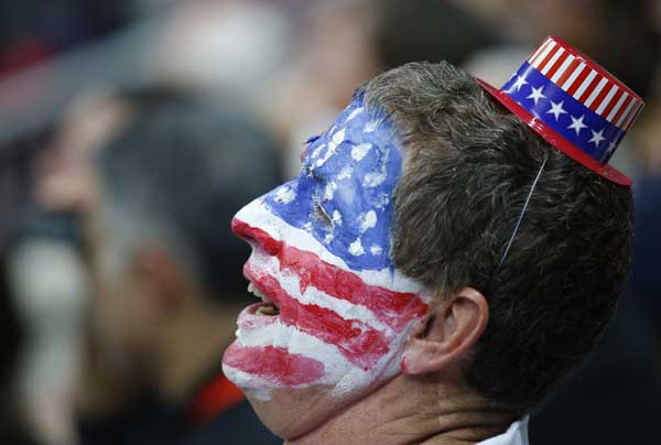 A fan cheers for Team USA during the first half of an of a preliminary men&#39;s basketball game France at the 2012 Summer Olympics, Friday, July 27, 2012, in London. <span class=meta>(AP Photo&#47;Jae C. Hong)</span>