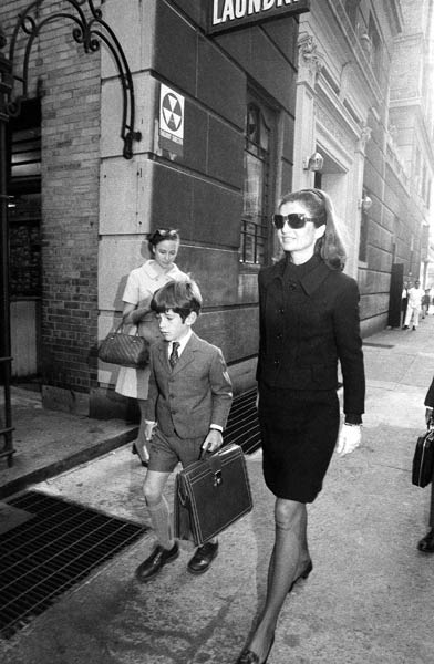John F. Kennedy Jr., 7, son of the late president, carries a man-sized briefcase as he walks toward the Collegiate School in New York, Sept. 20, 1968 to begin classes. John's mother, Mrs. Jacqueline Kennedy, accompanied him to school. (AP Photo)