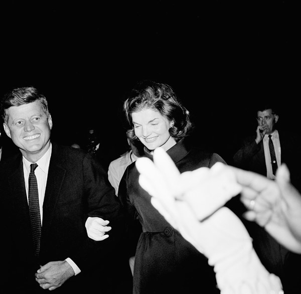 Arm and arm - Sen. John F. Kennedy of Massachusetts and his wife, Jacqueline, are a smiling pair, Oct. 7, 1960 as they attend a rally at Howard University, a college for African Americans in Washington. (AP photo)