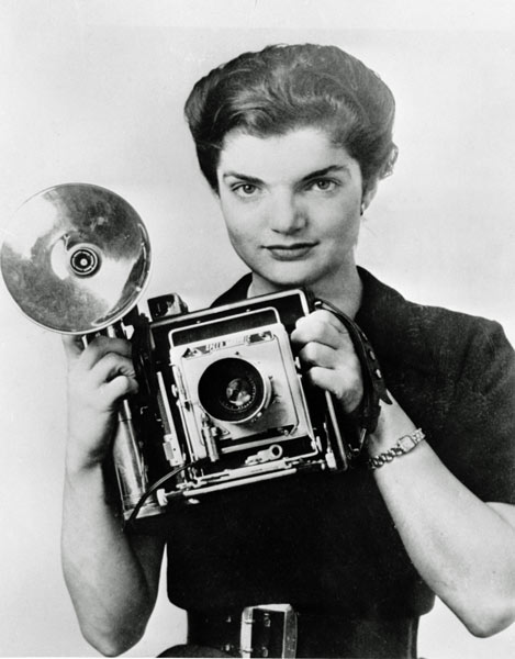 Jacqueline Bouvier Kennedy poses with a Speed Graphic press camera during her stint as an inquiring photographer for the Washington Times Herald in Washington, D.C., in 1953, the same year she married Sen. John F. Kennedy.  (AP Photo)