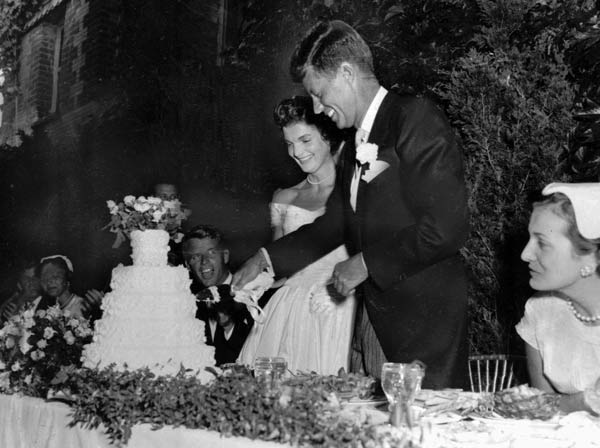 "<div class=""meta ""><span class=""caption-text "">U.S. Senator John F. Kennedy, D-Mass., and his bride, the former Jacqueline Lee Bouvier, cut their wedding cake during a reception following thier marriage Sept.12, 1953 at Newport, R.I.  (AP Photo)</span></div>"