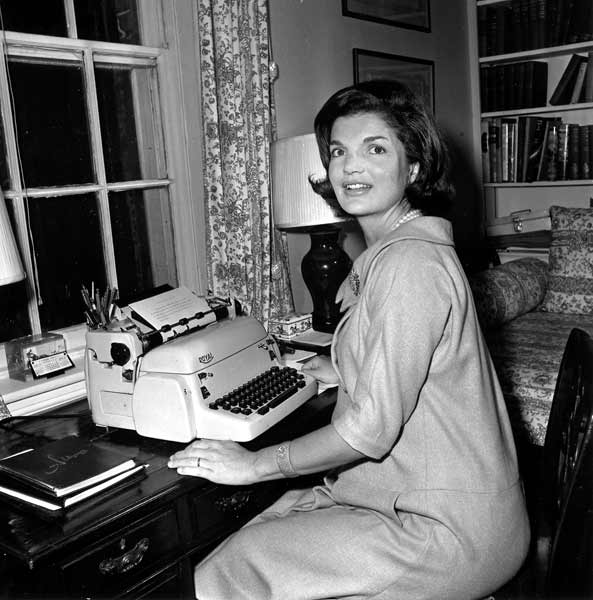 In this Oct. 5, 1960 file photo, Jacqueline Kennedy poses at her typewriter where she writes her weekly