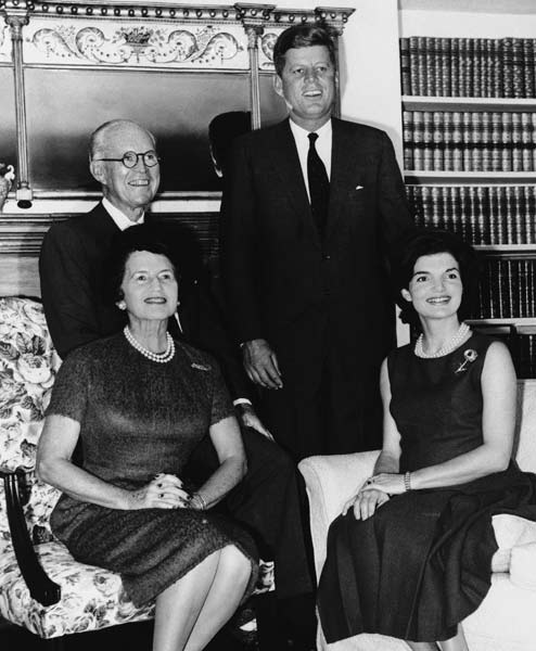 Following John F. Kennedy's election as president, the Kennedy clan gathered for this group photo at the Hyannisport, Mass. home of Joseph P. Kennedy, their father, on November 9, 1960.   Seated are Rose Kennedy, mother of John F. Kennedy, and Jacqueline Kennedy, at right, wife of the president-elect.   Joseph P. Kennedy, sits behind his wife, as President-elect John Kennedy stands.   (AP Photo)