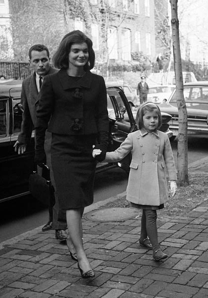 In this Dec. 6, 1963 file photo, Jacqueline Kennedy and her daughter, six-year-old Caroline, arrive at their new home in the Georgetown section of Washington two weeks after her husband was slain in Dallas, Texas. (AP Photo/Bob Schutz)