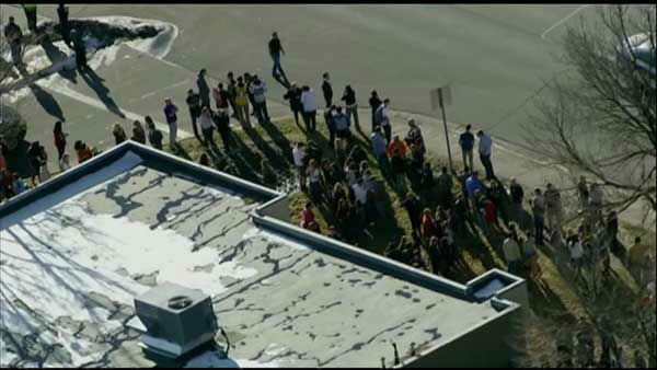 Colorado emergency officials say police are responding to a report of a shooting at a high school in suburban Denver.
