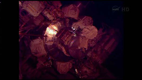Two space station astronauts popped in a new pump during a rare Christmas Eve spacewalk Tuesday, eager to wrap up urgent repairs to a cooling system.  <span class=meta>(WLS Photo)</span>