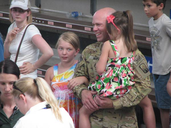 "<div class=""meta ""><span class=""caption-text "">Sgt. Howse holds his daughter, Nataja, after being reunited with her for the first time since last November on June 27, 2012. (Evan Peterson/ABC7Chicago.com)</span></div>"