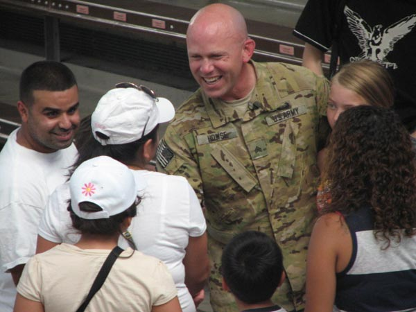 "<div class=""meta ""><span class=""caption-text "">After the dolphin show, Sgt. Howse is approached by people who thank him for his service on June 27, 2012. (Evan Peterson/ABC7Chicago.com)</span></div>"