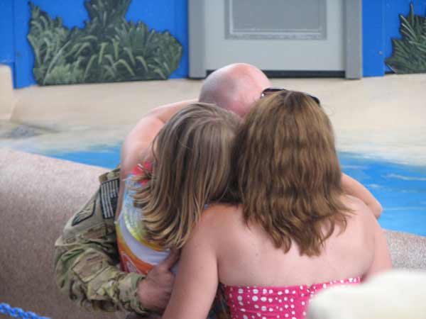 "<div class=""meta ""><span class=""caption-text "">Sgt. Howse gives his daughters a big hug after being reunited with them on June 27, 2012. (Evan Peterson/ABC7Chicago.com)</span></div>"