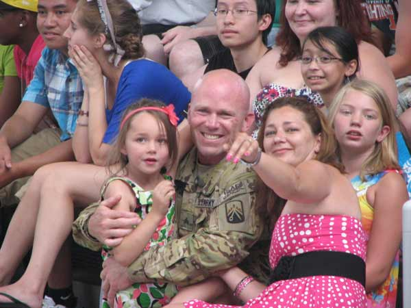 "<div class=""meta ""><span class=""caption-text "">Sgt. Howse and his family smile for the cameras on June 27, 2012. (Evan Peterson/ABC7Chicago.com)</span></div>"
