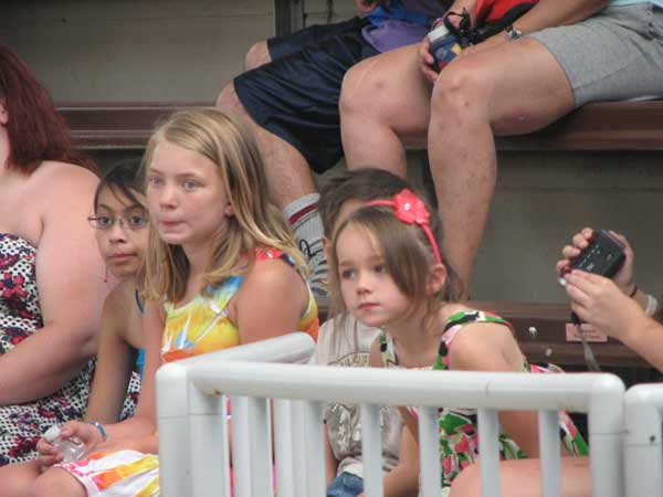 "<div class=""meta ""><span class=""caption-text "">Jorja Coleman (left), in the tie-dye, and Nataja Howse (right), in the floral dress, watch the dolphin show at Brookfield Zoo, unaware that their father is about to surprise them after a tour in Afghanistan. (Evan Peterson/ABC7Chicago.com)</span></div>"