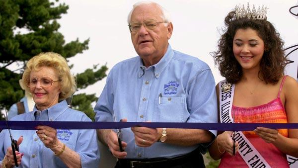 Then-Illinois Gov. George Ryan, center, his wife Lura Lynn, left, and Miss Illinois County Fair Queen Jenn Scheitlin, right,  cut the ribbon and open the Illinois State Fair in Springfield, Ill.,  Fri