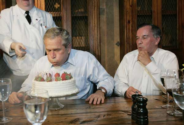President Bush, left, blows out the candles on his birthday cake as he celebrates with Richard M. Daley, right, Mayor of Chicago, at the Chicago Firehouse restaurant, Thursday, July 6, 2006 in Chicago. Bush turned sixty on Thursday. <span class=meta>( AP Photo&#47;Pablo Martinez Monsivais)</span>