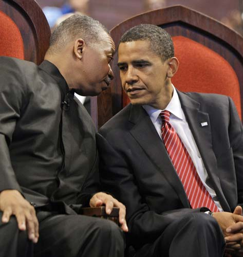 "<div class=""meta image-caption""><div class=""origin-logo origin-image ""><span></span></div><span class=""caption-text"">Democratic presidential candidate Sen. Barack Obama D-Ill., right, talks with Pastor Dr. Byron Brazier during the Apostolic Church of God service in Chicago, Sunday, June 15, 2008.(AP Photo/Alex Brandon)</span></div>"