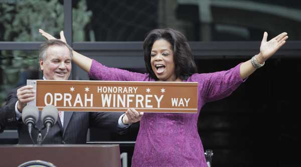 In one of his last acts before leaving office next week, Chicago Mayor Richard M. Daley presents TV talk-show host Oprah Winfrey with a sign after a street was named in her honor outside her Harpo Studios in Chicago, Wednesday, May 11, 2011. Winfrey will end her 25 year-run on daytime television in Chicago on May 25. <span class=meta>( AP Photo&#47;M. Spencer Green)</span>