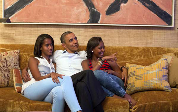 In this image released by the White House, President Barack Obama and his daughters, Malia, left, and Sasha, watch first lady Michelle Obama speak at the Democratic National Convention on television from the Treaty Room of the White House Tuesday, Sept. 4, 2012. &#40;AP Photo&#47;The White House, Pete Souza&#41; <span class=meta>(AP Photo&#47; Pete Souza)</span>
