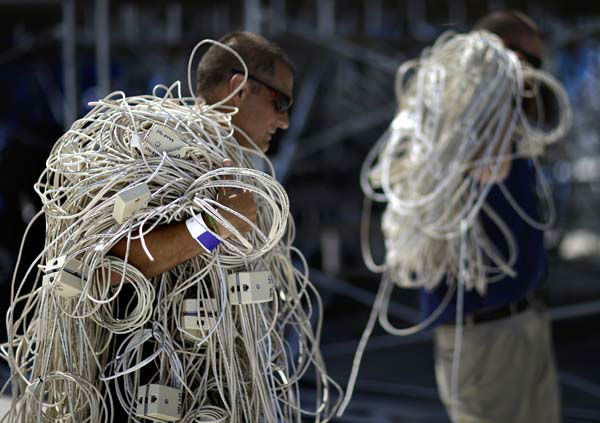 Technicians Jay Alcombright, left, and Jesse Mangum, pull phone wire from the Bank of America Stadium after Thursday&#39;s Democratic National Convention proceedings were moved to the Time Warner Cable Arena due to weather Wednesday, Sept. 5, 2012, in Charlotte, N.C. &#40;AP Photo&#47;David Goldman&#41; <span class=meta>(AP Photo&#47; David Goldman)</span>