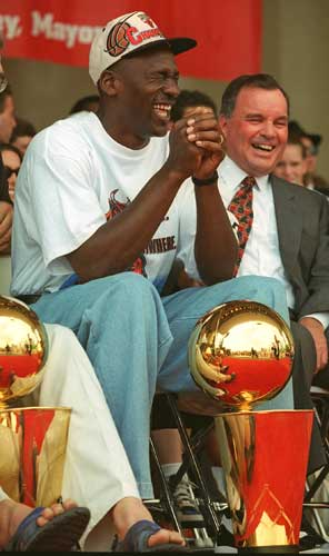 "<div class=""meta image-caption""><div class=""origin-logo origin-image ""><span></span></div><span class=""caption-text"">In this June 18, 1996 file photo, Chicago's Bulls' Michael Jordan, left, and Mayor Richard M. Daley share a light moment during the Bulls' fourth NBA championship celebration at Chicago's Grant Park.  (AP Photo/Beth Keiser, File)</span></div>"