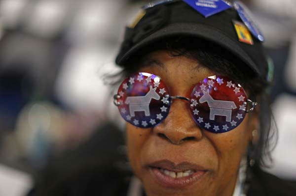 Vivian Stowall of Denver shows off her DNC themed glasses the Democratic National Convention in Charlotte, N.C., on Wednesday, Sept. 5, 2012. &#40;AP Photo&#47;Carolyn Kaster&#41; <span class=meta>(AP Photo&#47; Carolyn Kaster)</span>