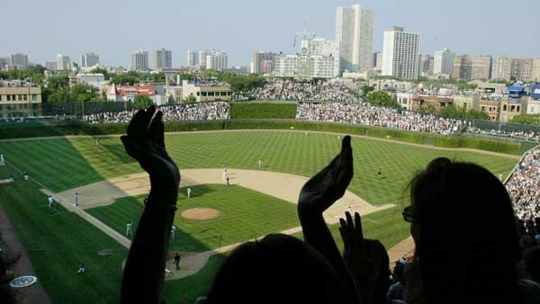 Baseball fans cheer in the upper deck of Wrigley field in Chicago during a game between the Chicago Cubs and the St. Louis Cardinals in this Aug. 30, 2002. [FILE]