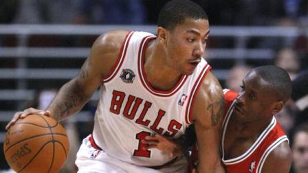 Chicago Bulls guard Derrick Rose, left, tries to drive on Milwaukee Bucks guard Earl Boykins during the first half of an NBA basketball game Monday, Jan. 24, 2011, in Chicago. (AP Photo/Charles Rex Arbogast)