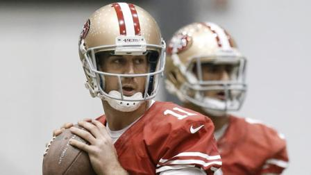 San Francisco 49ers quarterbacks Alex Smith (11) and Colin Kaepernick, right, throw during practice in New Orleans.