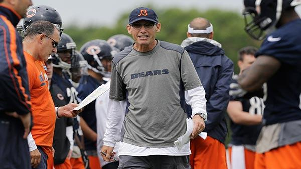 Chicago Bears head coach Marc Trestman talks to his team during NFL football training camp Friday, July 26, 2013, at Olivet Nazarene University in Bourbonnais, Ill. (AP Photo/Nam Y. Huh)