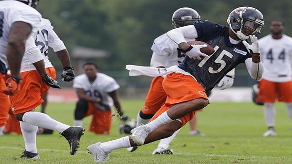 Chicago Bears wide receiver Brandon Marshall (15) runs with a ball during NFL football training camp Saturday, July 27, 2013, at Olivet Nazarene University in Bourbonnais, Ill. (AP Photo/Nam Y. Huh)