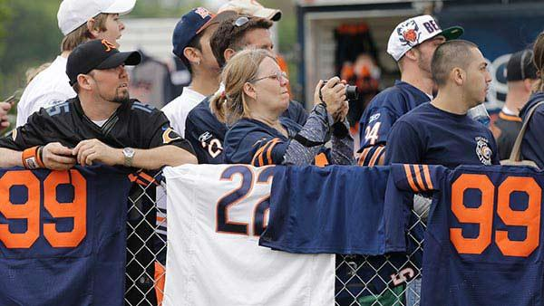 Chicago Bears fans watch players during NFL football training camp Saturday, July 27, 2013, at Olivet Nazarene University in Bourbonnais, Ill. (AP Photo/Nam Y. Huh)