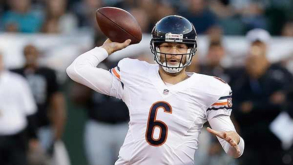 Chicago Bears quarterback Jay Cutler (6) passes against the Oakland Raiders during the first quarter of an NFL preseason football game in Oakland, Calif., Friday, Aug. 23, 2013. (AP Photo/Ben Margot)