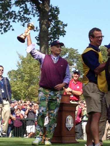 Bill Murray holds up the #RyderCup. Via @RaferWeigel