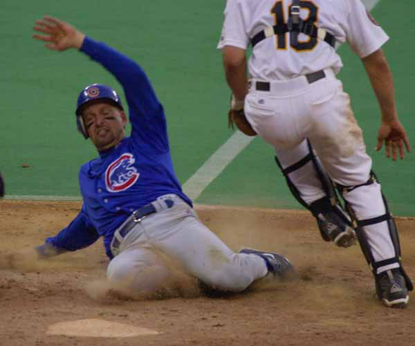 Chicago Cubs Mark Grace, left, scores the winning run in the eighth inning past Pittsburgh Pirates catcher Jason Kendall &#40;18&#41; Sunday Oct. 1, 2000 in Pittsburgh. The Cubs beat the Pirates 10-9 in the last baseball game ever to be played in Three Rivers Stadium.  &#40;AP Photo&#47;Gene J. Puskar&#41; <span class=meta>(AP Photo&#47; GENE J. PUSKAR)</span>