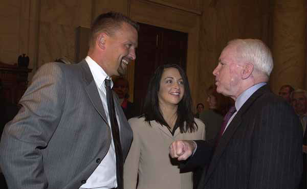 Arizona Diamondbacks first baseman Mark Grace,left, and his wife Tanya talk to Sen. John  McCain, R-Ariz., during a tour of Capitol Hill Thursday, Dec. 13, 2001.  &#40;AP Photo&#47;Dennis Cook&#41; <span class=meta>(AP Photo&#47; DENNIS COOK)</span>