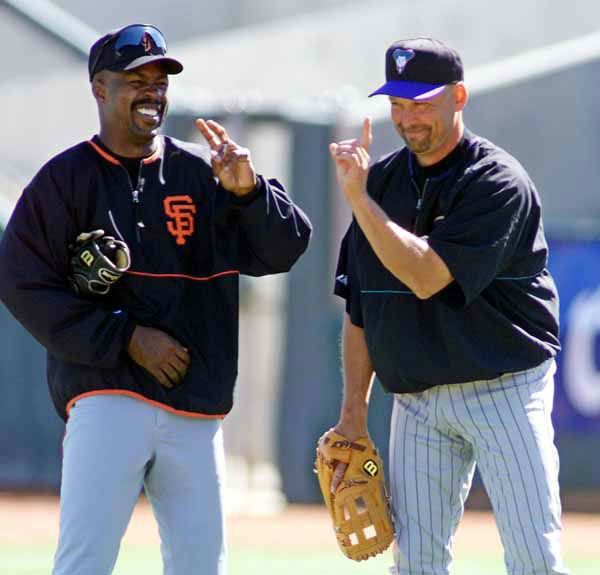 Arizona Diamondbacks first baseman Mark Grace, right, laughs with San Francisco Giants&#39; Shawon Dunston, left, during batting practice before their game in Scottsdale, Ariz., Saturday March 9, 2002.  The pair formerly played together for the Chicago Cubs. &#40;AP Photo&#47;Eric Risberg&#41; <span class=meta>(AP Photo&#47; ERIC RISBERG)</span>