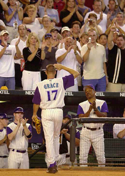 Arizona Diamondbacks first baseman Mark Grace salutes fans as he leaves the field for the last time when he was replaced against the St. Louis Cardinals in the seventh inning Sunday, Sept. 28, 2003, in Phoenix.&#40;AP Photo&#47;Paul Connors&#41; <span class=meta>(AP Photo&#47; PAUL CONNORS)</span>