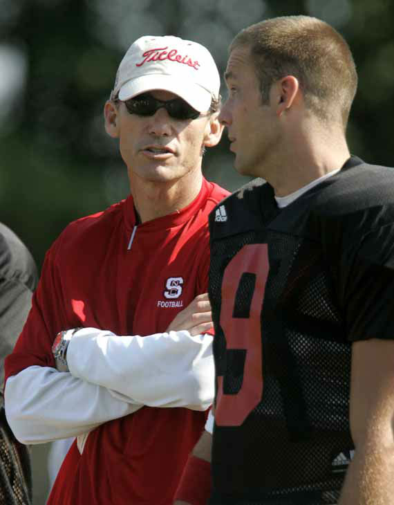 North Carolina State offensive coordinator Marc Trestman, left, talks with quarterback Marcus Stone &#40;9&#41; during football practice, Monday, Aug. 14, 2006 in Raleigh, N.C. Stone led the Wolfpack&#39;s midseason revival last season, starting the final six games and passing for 1,015 yards and eight touchdowns. &#40;AP Photo&#47;Gerry Broome&#41; <span class=meta>(AP Photo&#47; GERRY BROOME)</span>