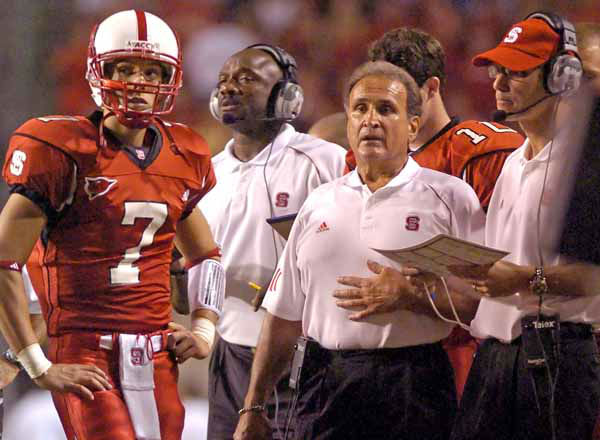 North Carolina State football coach Chuck Amato, center, talks with quarterback Daniel Evans &#40;7&#41; and offensive coordinator Marc Trestman, right, during the first half against Boston College, Sept. 23, 2006, in Raleigh, N.C. The Wolfpack has won consecutive games against ranked opponents to change the feel of the season. And that has the program sitting alone atop the league&#39;s Atlantic Division heading into Saturday&#39;s game against Wake Forest.&#40;AP Photo&#47;Stan Gilliland&#41; <span class=meta>(AP Photo&#47; KARL DEBLAKER)</span>