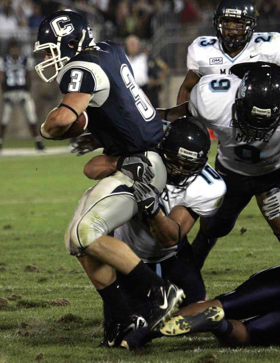 Connecticut&#39;s Brad Kanuch &#40;3&#41; is stopped after a gain in the first half of the UConn- Maine football game in East Hartford, Conn., Saturday, Sept. 8, 2007, by Maine&#39;s Andrew Downey. Coming in on the play are Maine&#39;s Jovan Belcher &#40;9&#41; and Brandon McLaughlin &#40;23&#41;.  &#40;AP Photo&#47;Bob Child&#41; <span class=meta>(AP Photo&#47; Bob Child)</span>