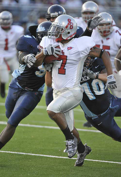 Stony Brook wide receiver Dwayne Fley &#40;7&#41;  gets hauled down from behind by Maine&#39;s Jovan Belcher &#40;9&#41; and Andrew Downey &#40;10&#41; in the first half of their NCAA college football  game in Orono, Maine, Saturday, Sept. 13, 2008. &#40;AP Photo&#47;Michael C. York&#41; <span class=meta>(AP Photo&#47; Michael C. York)</span>