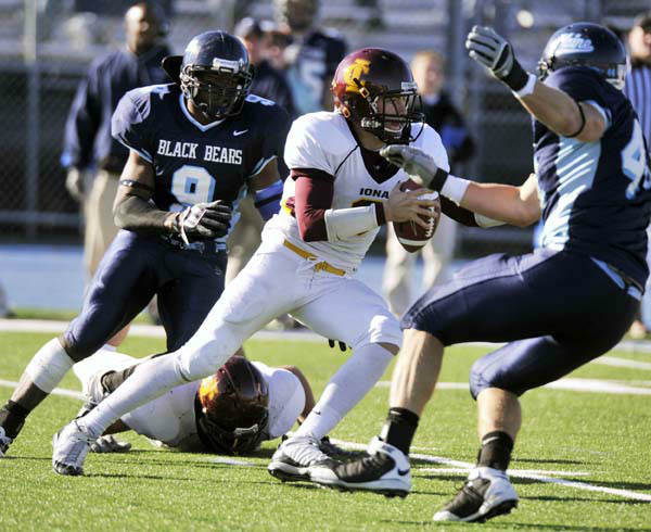 Iona quarterback Warren Smith &#40;8&#41;  has to scramble from Maine&#39;s Jovan Belcher &#40;9&#41; and Jordan Stevens &#40;44&#41; during the third quarter of an NCAA football game in Orono, Maine, Saturday, Nov. 1, 2008.&#40;AP Photo&#47;Michael C. York&#41; <span class=meta>(AP Photo&#47; Michael C. York)</span>