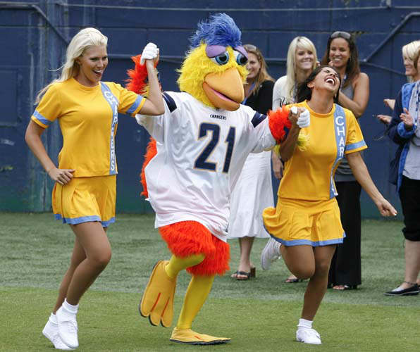 6. San Diego Chicken, San Diego Padres: The San Diego Chicken, center, runs onto the field with two San Diego Chargers cheerleaders during a Chargers news conference held at Qualcomm Stadium Monday, June 1, 2009.    <span class=meta>(AP Photo&#47; Denis Poroy)</span>