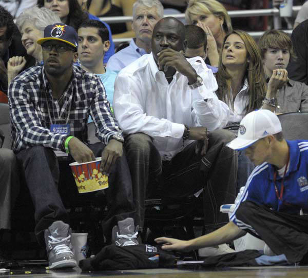 Charlotte Bobcats majority owner Michael Jordan, center, watches the second half of Game 2 of a first round NBA basketball playoff game between the Orlando Magic and the Charlotte Bobcats in Orlando, Fla., Wednesday, April 21, 2010.  Sitting next to him are his son, Marcus Jordan, left, and Yvette Prieto, right. &#40;AP Photo&#47;Phelan M. Ebenhack&#41; <span class=meta>(AP Photo&#47; Phelan M. Ebenhack)</span>