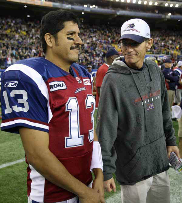 Montreal Alouettes quarterback Anthony Calvillo, left, and head coach Marc Trestman watch the end of the game against the Toronto Argonauts on their way to a 48-9 victory in the Canadian Football League Eastern Final action Sunday, November 21, 2010 in Montreal. &#40;THE CANADIAN PRESS&#47;Ryan Remiorz&#41; <span class=meta>(Photo&#47;Ryan Remiorz)</span>